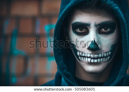 skull makeup portrait of young man halloween face art