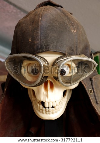 skull motorcycle goggles and helmet vintage - stock photo