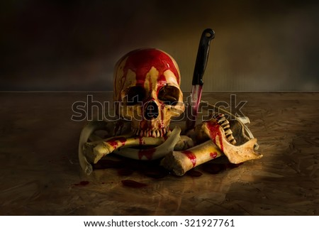 Skull  murder with knife and bloody, Still Life style - stock photo