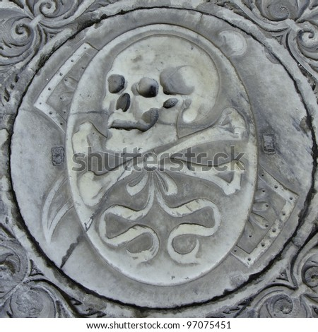 Skull on the cathedral crypt. Pisa. Italy - stock photo