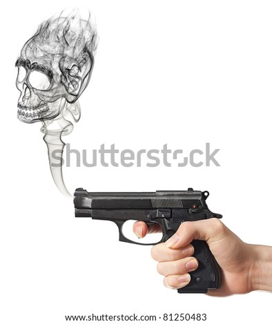 Skull shaped smoke from gun after shooting. - stock photo