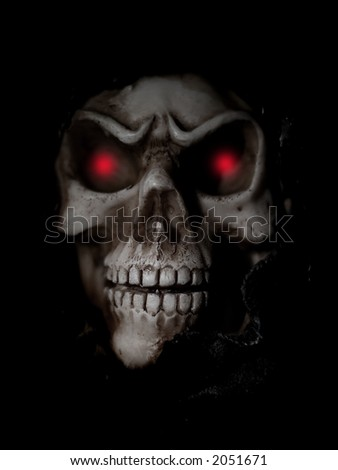 Skull with a black background and shallow DOF - stock photo
