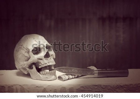 Skull with Classic Knives In vintage tone.- Still life style