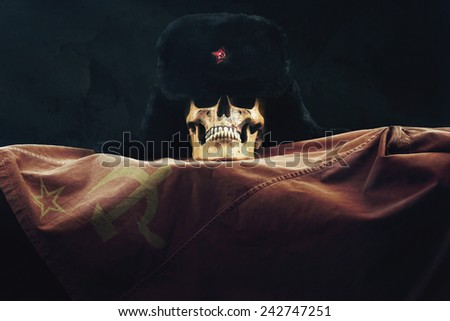 Skull with Russian Uschanka and old Flag - stock photo