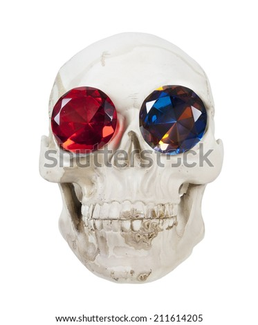 Skull with teeth and gems in the eye sockets - path included - stock photo