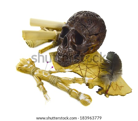 Skull with voodoo doll isolated - stock photo