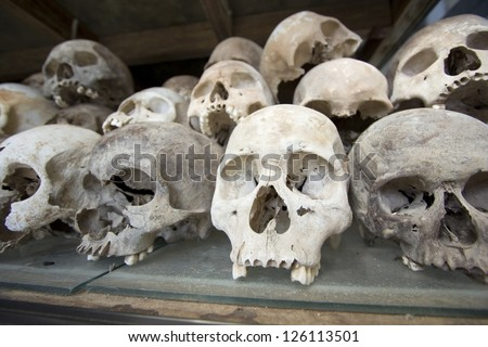 Skulls and bones in Killing field, Cambodia - stock photo