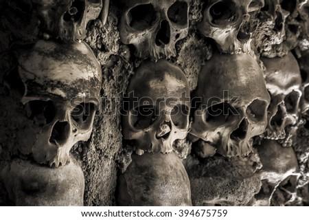 Skulls and bones in the chapel  - stock photo