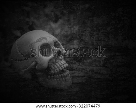 Skulls, skeletons on the scrap heap of rotting leaves. Spooky, scary, Monochrome Black and White, rupture