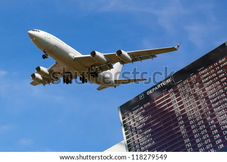 sky, airliner, Airport flight schedule with the list of flights - stock photo
