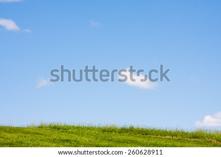 Sky and a few clouds and lots of copy space. - stock photo