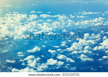 sky and background concept - blue sky with white clouds - stock photo