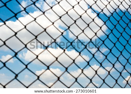 Sky and clouds, blur fence