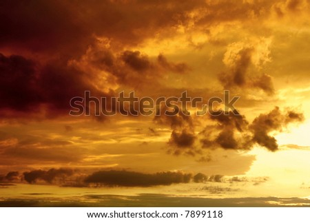 Sky and clouds in last beams of the sun. - stock photo