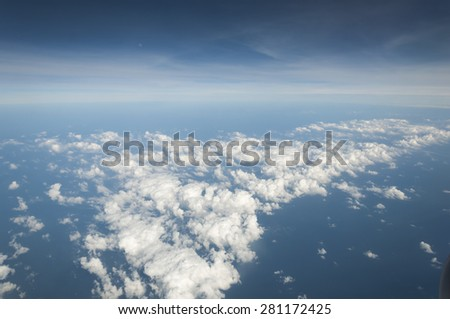 Sky and clouds looking from the Airplane - stock photo