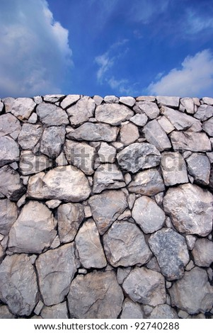 Sky and Stone wall background - stock photo