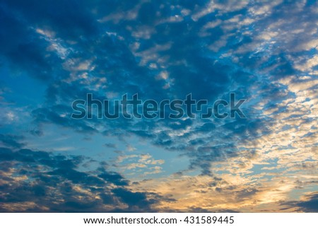 Sky Background, Blue, Orange And Yellow Colors Sunset Sunrise. Colorful sunset with clouds in the evening - stock photo