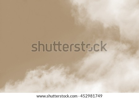 Sky background in Sepia color effect: blue sky background with white cloud in sepia effect - stock photo