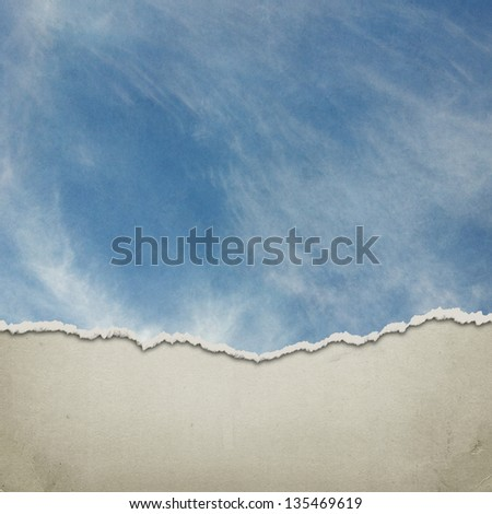 Sky background on torn paper - stock photo