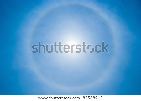 sky background with sun circular rainbow halo - stock photo