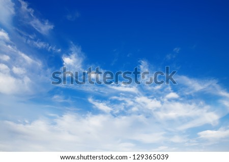 Sky background with the fluffy white clouds - stock photo