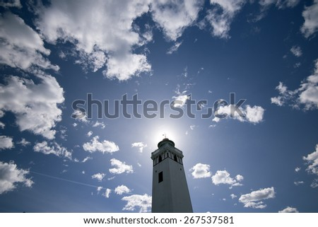 Sky blue lighthouse from Strib close to Little Belt and Fredericia in Denmark - stock photo