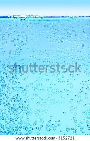 sky champagne - lots of bubbles illuminate from beneath - stock photo
