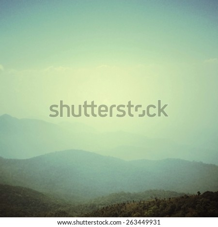 Sky , cloud , tree and mountain with retro filter effect or instagram filter - stock photo