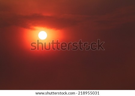 Sky filled with smoke from a forest fire.  The Carlton Complex wild fire was Washington State's largest fire - ever!  Smoke blocked out the sun and made it too dangerous for emergency aircraft to fly. - stock photo
