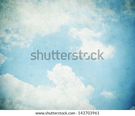 Sky, fog, and clouds on a textured, vintage paper background with grunge stains. - stock photo