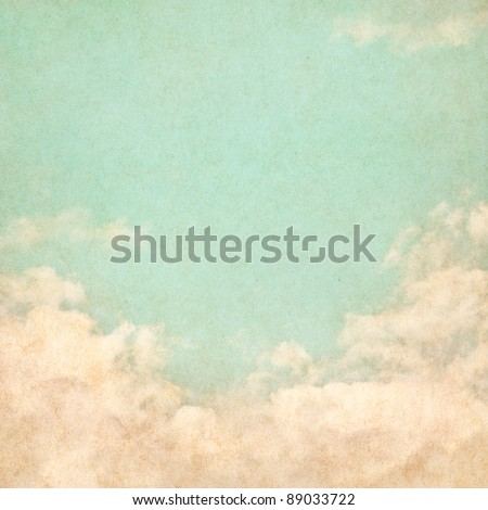Sky, fog, and clouds on a textured, vintage paper background with grunge stains.