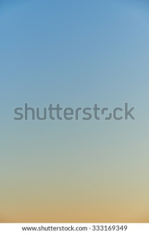 sky gradient from blue to orange at dusk - stock photo