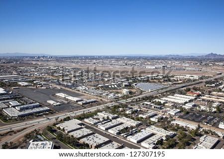 Sky Harbor International Airport with  Phoenix, Arizona city skyline in the distance - stock photo