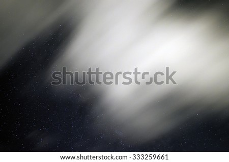 Sky in the night with stars and clouds blurry beccause they are in long exposure in summertime - stock photo