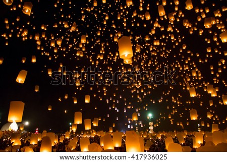 Sky lanterns, flying lanterns, floating lanterns, hot-air balloons Loy Krathong Festival in Chiang Mai Thailand - stock photo