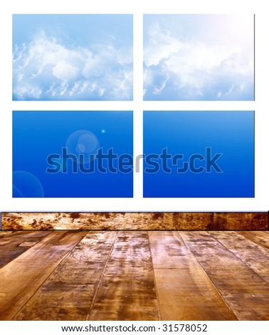 Sky on window of room with wooden floor - stock photo
