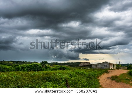 Sky overcast, awaiting heavy rains over cottage in the valley of UNESCO world heritage site of Vinales / Viñales, Cuba.