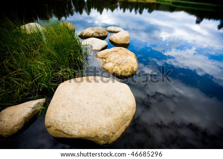 Sky reflected in Mountain Lake - stock photo