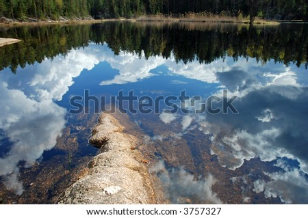 sky reflection in a lake - stock photo