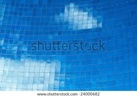 Sky reflection in the rounded mirrored wall - stock photo