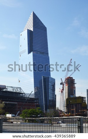 Sky scrappers by a building under construction in Manhattan, New York city, USA