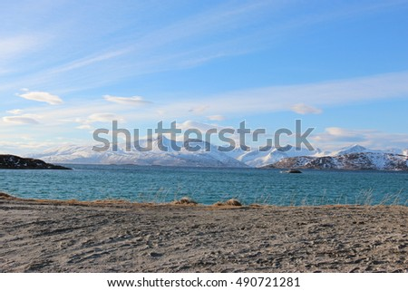 Sky Sea and Snow Mountain in Tromso Norway