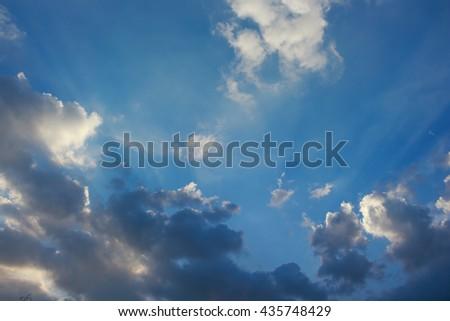 sky season rain storm clouds sunlight rays of light - stock photo