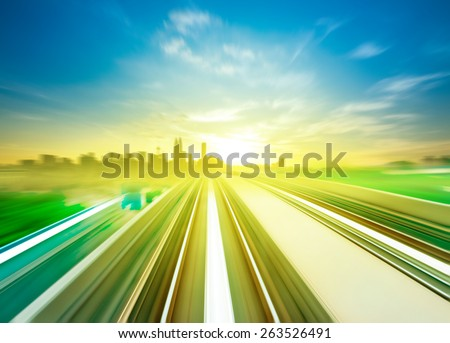 Sky Train moving fast towards Kuala Lumpur city center, Malaysia. - stock photo