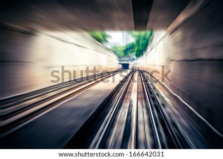 Sky train through the tunnel,motion blur - stock photo