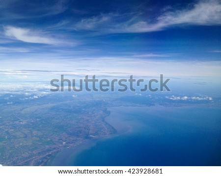 sky view from airplane, sky of island, sky of thailand, sky view, sky photo, sky and cloud, sky backgrounds, sky. - stock photo