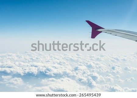 Sky view from airplane window. - stock photo