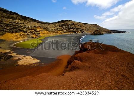 sky  water  in el golfo lanzarote spain musk pond rock stone  coastline and summer  - stock photo