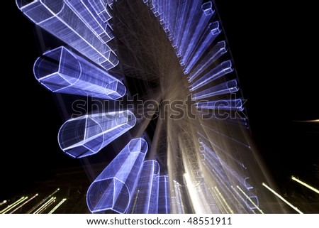 Sky wheel illuminated at night