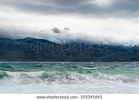 Sky with clouds and stormy waves in the sea - stock photo